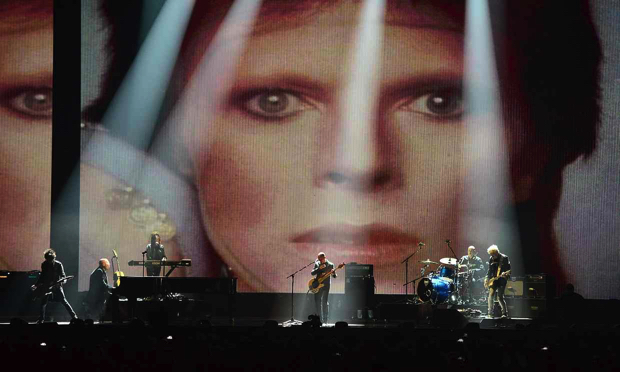 David Bowie's band perform on stage during the 2016 Brit awards at the O2, London. Photograph- Dominic Lipinski-PA