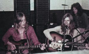 "Mick ""Woody"" Woodmansey, back right, in the studio with Mick Ronson, left, and David Bowie"